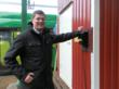 Mikael Öhlund, CEO Umeå Municipality, flips the switch of the charging station