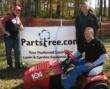 Partstree.com CEO Andy Fogarasi (r) with USLMRA President Bruce Kaufman (l) and Hall of Fame Racer Chuck Miller (front).