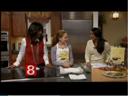 """Cook Your Way Through The S.A.T."" author Charis Freiman-Mendel, the S.A.T. gourmet, demonstrates her recipe for ""fish in parchment"" on WTNH Channel 8"