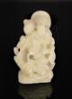 White Jade Figure of Liuhai with Toad Climbing String of Gold Coins.
