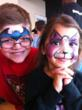 Kidd's Kids Patients show off their painted faces between appointments