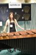 Eriko Daimo plays marimba at Marimba One booth at PASIC