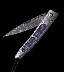 The 'Ventana' Pocketknife inlaid with 178 dark and light blue sapphires