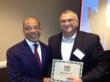 RiseSmart CEO Sanjay Sathe accepts 2011 Red Herring Global Top 100 award from Alex Vieux, chairman of Red Herring.