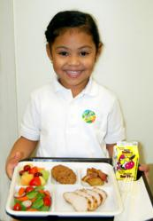 Student with La Prima school lunch