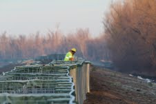 Worker helps deploys HESCO Concertainer units on levee to protect and preserve critical crops and infrastructure in Southeast Missouri.