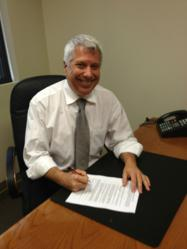 Dave Neal Signing Code of Fair Campaign Practices