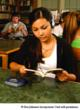 girl with headphones engaged in reading