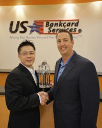 Elavon CEO Mike Passilla presenting the Arch Award to USBSI President Chris Chang at the USBSI offices