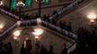 Guests descend the Grand Staircase of the Metropolitan Club to the Ballroom for the Ballo di Savoia,