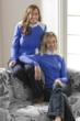 Designer sisters, Cori and Bobbi Windsor sitting together on sofa.