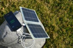 This solar charger runs and charges your device