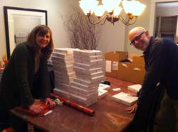 It's a Wrap: Patti Winegar and Larry Margolis, Managing Partners of SPM Marketing & Communications in LaGrange, IL put the finishing touches on best employee Christmas gift of the year--an iPad2 for all 40 employees.