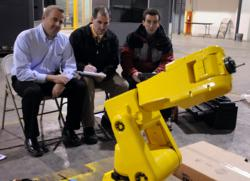 Jim Shaffer, Ray Setaro, and Jon Seaman programming a FANUC ArcMate 50iL industrial robot
