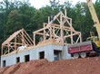 Timber-framed house starts with Superior Walls foundation.