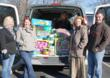Spectrum Surgical employees load the cargo van to drop-off the company donation of new items to Good Neighbors Charity.