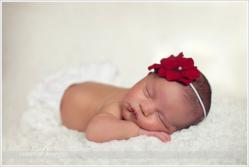 Baby Girl with Red Bow by NJ Newborn Photographer Christine DeSavino