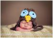 Newborn boy with owl hat by NY Photographer Christine DeSavino