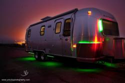 Exterior of Green RV at Night Showing Coloring Changing LED Lights