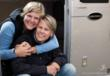 Cece Reinhardt and Brenda Daugherty in front of the green retrofitted Airstream