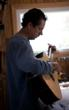 Luthier Jay Lichty playing the first tune on a new guitar