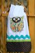 Towel depicting a creative picture of an owl is an example of their new product line.