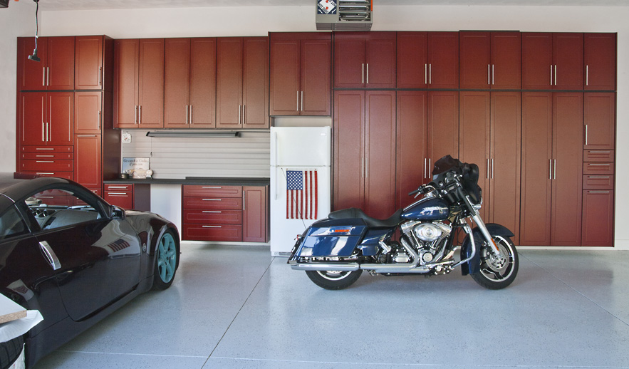 Garage CabinetsIf you are wondering how to organize a garage with a  compressor  lawn mower  or golf clubs you want to hide  we have the  solution for you. Garage Makeover Company to Offer Powder Coated Wood Garage Cabinets