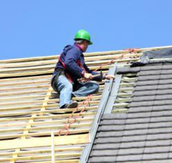 Roofing Contractor on Roof in Phoenix