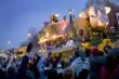 A Mardi Gras float rolls in a parade in Shreveport-Bossier.