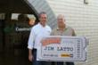 """Empire President and CEO Jeff Whiteman awards Jim Latto of DBA Construction the """"Get in the Game"""" Grand Prize"""
