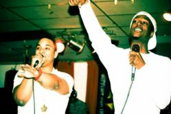 KL and Amos Perform together on stage.