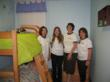 BD volunteer team in room they decorated at Hope Residence