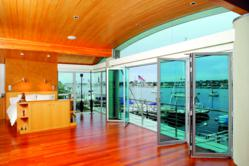 NanaWall folding glass wall with Dynamic Glass. The glass changes tints on demand to reduce glare, heat loss and heat gai