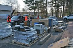 Employees at Miller Recycling Corporation gather and sort e-waste.