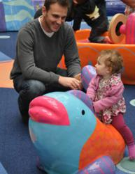 Father and daughter enjoy playtime at Westfield Fashion Square's new indoor playground.