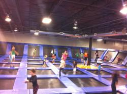 Kids and Adults Jumping at Urban Air Trampoline Park