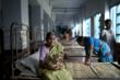 A grandmother holds her newborn grandchild at Bollobhpur Hospital. (Web resolution)