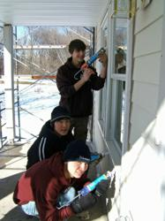 Volunteers work to finish a Twin Cities Habitat home