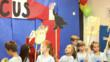 "Students from ""Mr.V's"" class in Northbrook, Ill., march with circus animal signs they created from a downloadable performance of The Circus from Mr. Rhythm's Children's Plays."