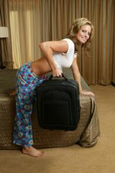 "Courtney Friel demonstrates the lat exercise, ""Luggage Lift."""
