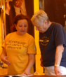A Scientology Volunteer Minister shows a visitor to the tent at the Manatee County Fair a step-by-step solution to a problem.