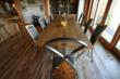 Fine woodworking with reclaimed wood allows craftsmen to create truly one-of-a-kind pieces like this sleeper board, bookended table and custom chairs.