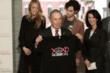 "New York City Mayor Michael R. Bloomberg shows off a Gossip Girl ""Made in NY"" XOXO T-shirt (foreground), with Gossip Girl series stars Blake Lively (back left) and Penn Badgley (back right), as well a"