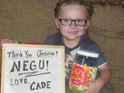 Young cancer patient with his Joy Jar from The NEGU Foundation