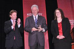 President Bill Clinton accepts the Wonk of the Year Award from American University. Standing with President Clinton is American University President Neil Kerwin and student Alex Kreger '14