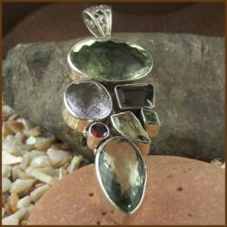http://www.kvspasal.com/collections/sterling-silver/pendants/green-purple-amethyst