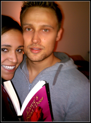 Newly weds, Jordan Tant and Emily James with personalized proposal novel, Love's Next Door