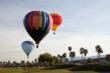 Balloons glide over the CasaBlanca Golf Club during the inaugural Mesquite Hot Air Balloon Festival.