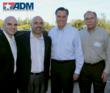 VP of Marketing, Jeff Raimonde, VP of Sales, Scott Powers, and President of ADM, Steve Powers gather with Romney during his visit.
