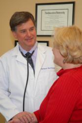 Dr. Thomas Mattioni with patient